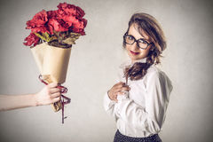 Girl with flowers. Girl man has some flowers Royalty Free Stock Image