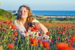 Girl with flowers near the sea. Stock Photography