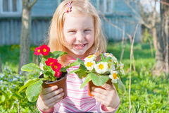 Girl with flowers outdoor Stock Photo