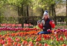 Girl in Flowers in the park Keukenhof Stock Photos