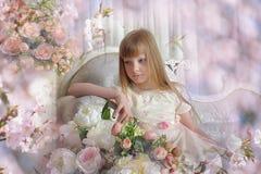 Girl among the flowers Stock Photo