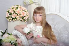 Girl among the flowers Stock Photography