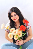 Girl with flowers smiling Royalty Free Stock Photos