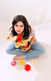 Girl with flowers smiling Stock Images