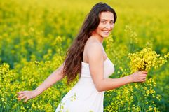 Girl with flowers at summer field Stock Photo