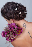 Girl with flowers and tattoo. Photo in studio royalty free stock photos