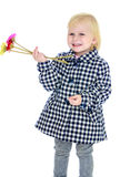 Girl with flowers in their hands Stock Photos