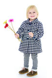 Girl with flowers in their hands Stock Images