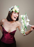 Girl with flowers white tulips laughs, sings Stock Photos