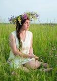 Girl in flowers wreath Stock Image