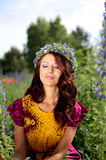 Girl with flowers' wreath Stock Photography