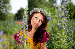 Girl with flowers' wreath Royalty Free Stock Image