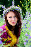 Girl with flowers' wreath Royalty Free Stock Images