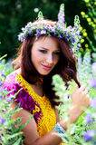Girl with flowers' wreath Royalty Free Stock Photography