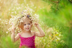 Girl with flowers. Girl with a wreath of flowers on her head stock photo
