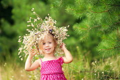 Girl with flowers. Girl with a wreath of flowers on her head royalty free stock image