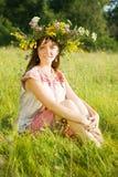 Girl in flowers wreath  on meadow Stock Photos