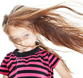 Girl with flowing hair. Little girl with hair fluttering in the wind Royalty Free Stock Photos