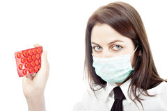 Girl in flu mask holding drugs Royalty Free Stock Photo