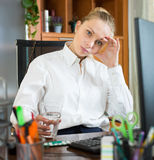 Girl with flue and pills at office Stock Image