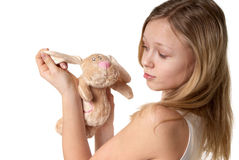 Girl and a fluffy bunny Royalty Free Stock Photography