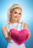 Girl with a fluffy heart Royalty Free Stock Photography