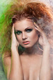 Girl with fluffy red hair Royalty Free Stock Photo