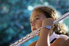 Girl with a flute. Listening to her teacher Royalty Free Stock Photos