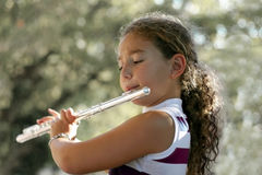 Girl with a flute. Girl playing a flute Stock Photos