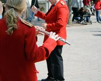 Girl with a flute. A girl playing flute in a brass-band Stock Photos