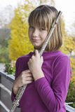 Girl with flute Royalty Free Stock Photo
