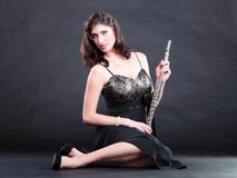Girl and flute on a black background Royalty Free Stock Photo