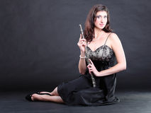 Girl and flute on a black background Royalty Free Stock Photos
