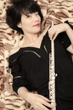 Girl and flute Stock Photography