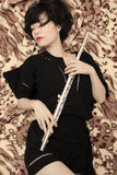 Girl and flute Royalty Free Stock Photo