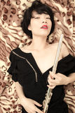Girl and flute Royalty Free Stock Images