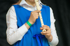 Girl with flute. Royalty Free Stock Photos