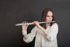 Girl with a flute Royalty Free Stock Images