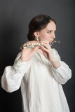 Girl with a flute Royalty Free Stock Photo