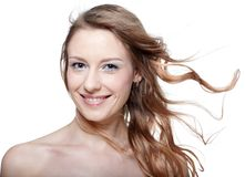 Girl with fluttering hair Stock Image