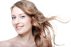 Girl with fluttering hair Stock Photos
