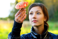 Girl with fly agaric Stock Photo