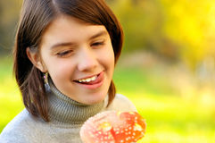 Girl with fly agaric Stock Photography