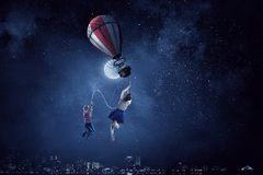 Girl fly in sky. Mixed media royalty free illustration