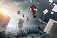Girl fly in sky. Mixed media royalty free stock image