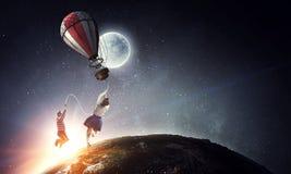 Girl fly in sky. Mixed media stock photo