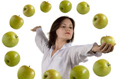 Girl and flying apple. On white royalty free stock images