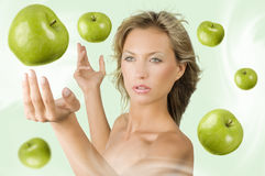 Girl with flying apple Stock Photos