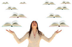Girl with Flying Books Royalty Free Stock Photography