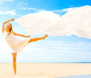Girl with flying cloth Stock Photography